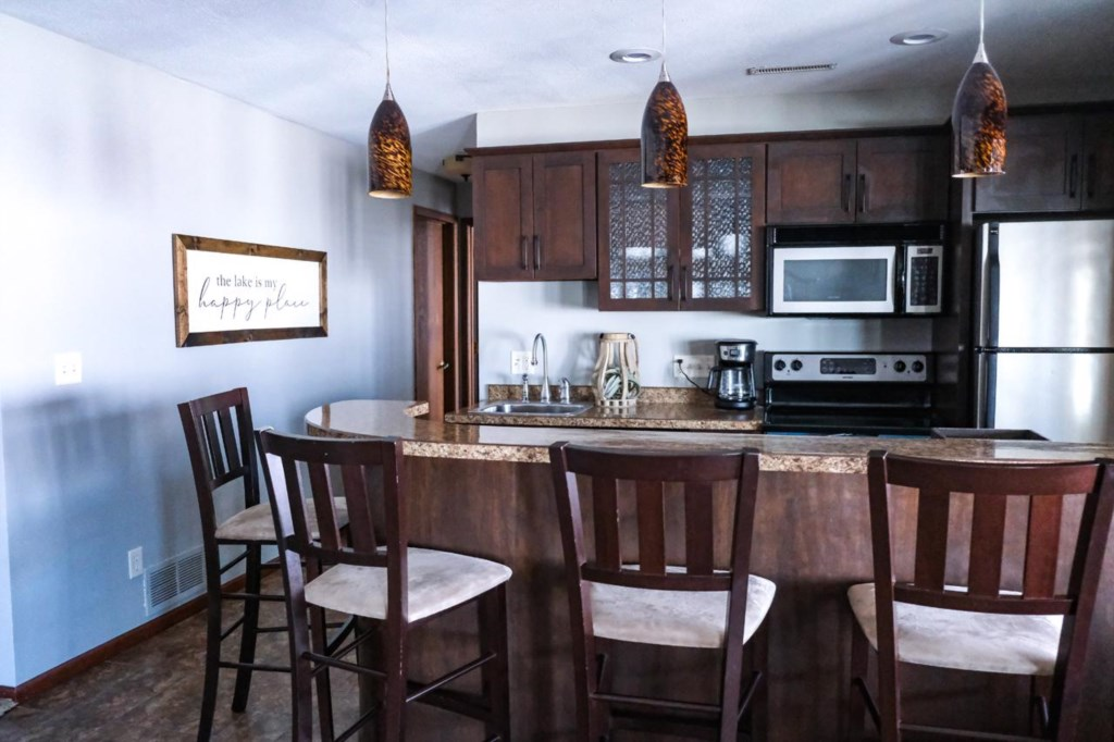 Lower level kitchen provides extra prep and entertaining areas.