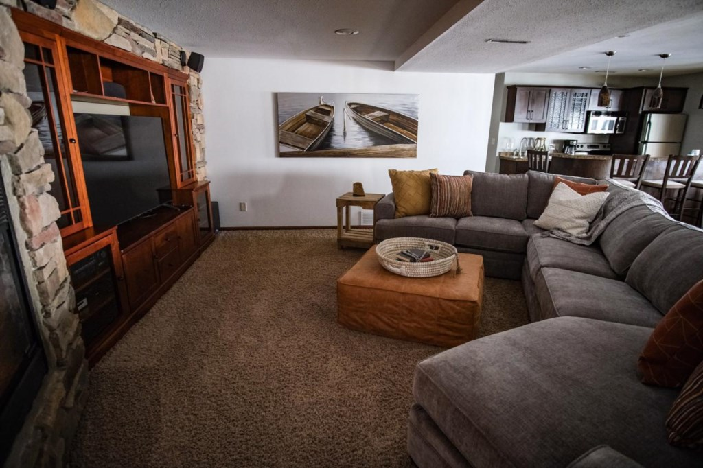 Lower level entertainment area with gas fireplace.