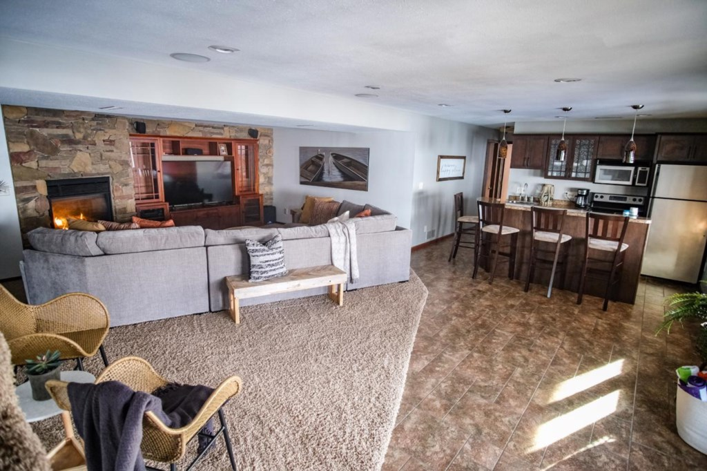 Full view of this beautiful lower level entertainment space.