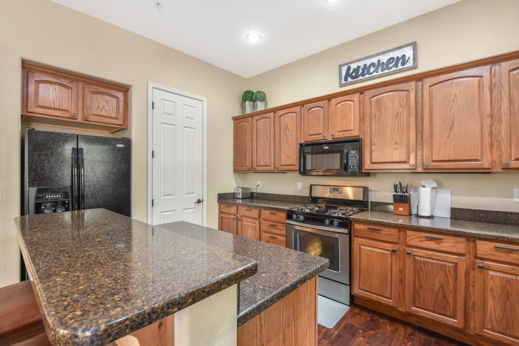 Open kitchen with breakfast bar seating