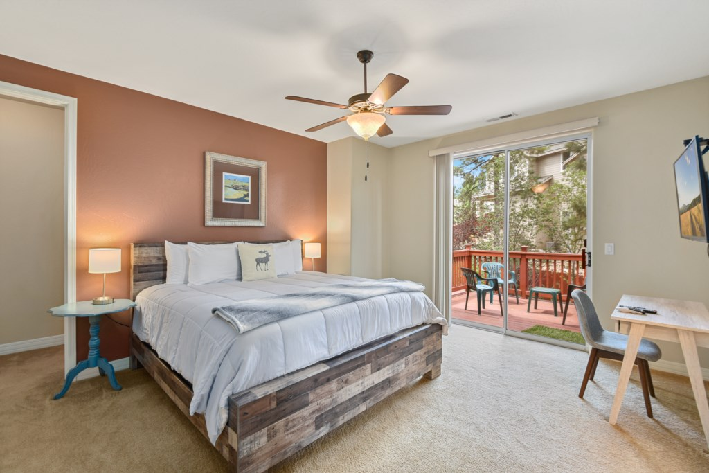 Master bedroom with king size bed, and private deck