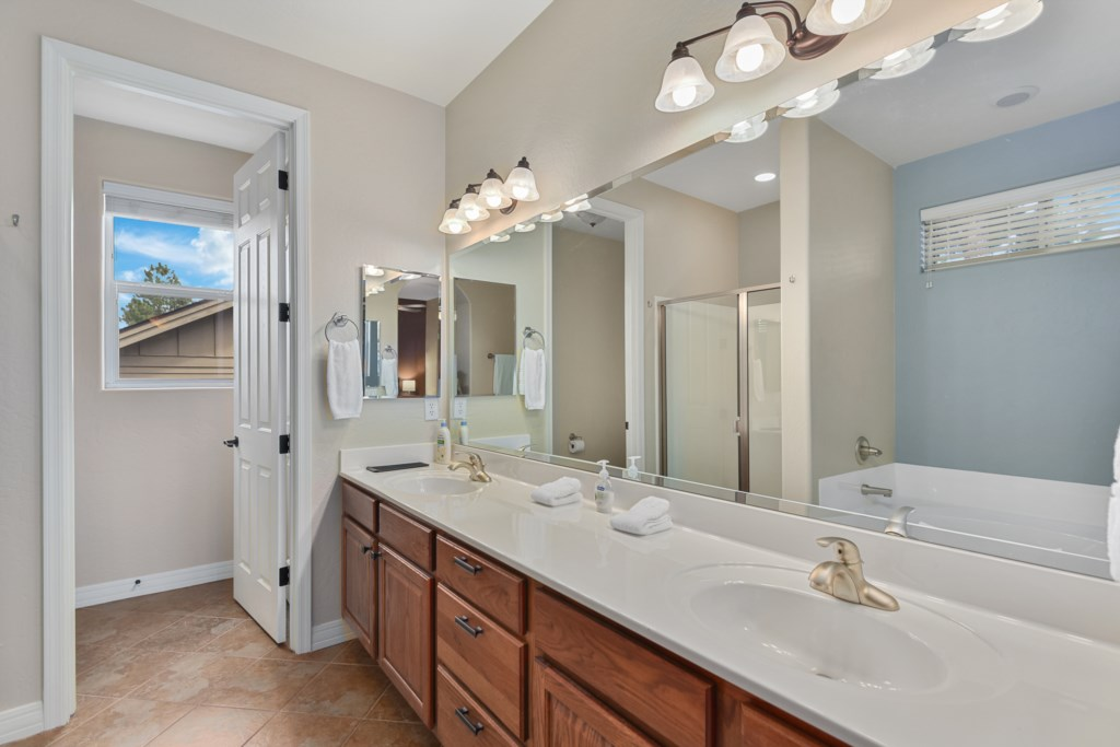 Master bathroom, dual sinks, separate tub and shower.