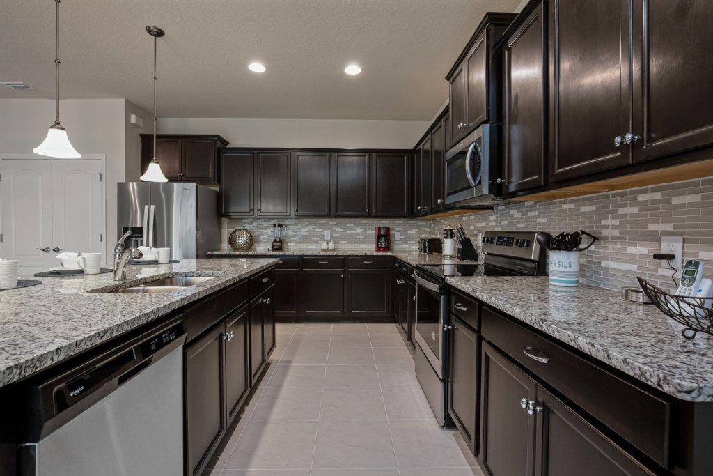 Modern style kitchen with blender, coffee maker, and toaster