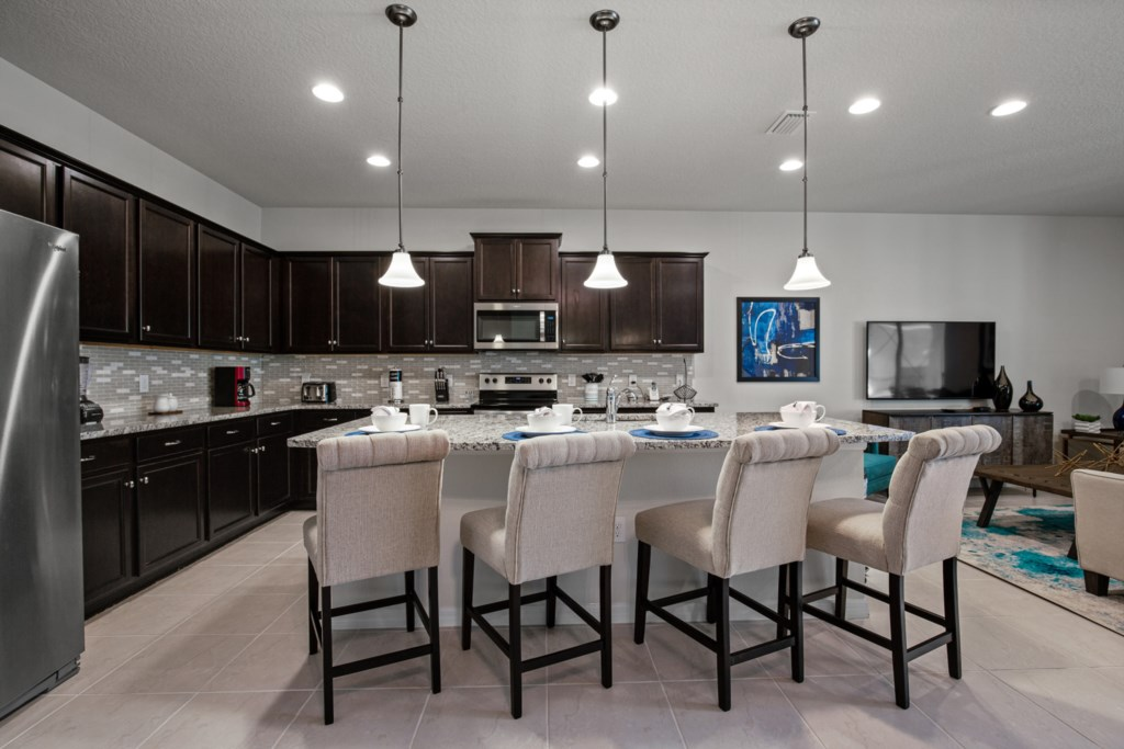 Classy barstool seating facing the kitchen