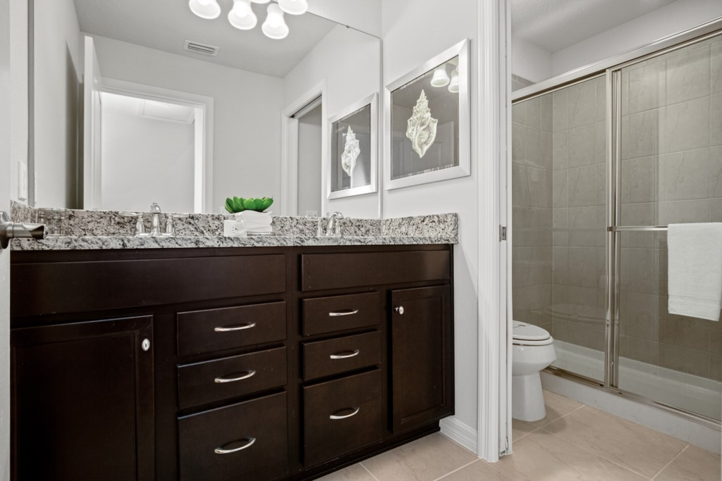 Classy bathroom with vanity, shower, and toilet