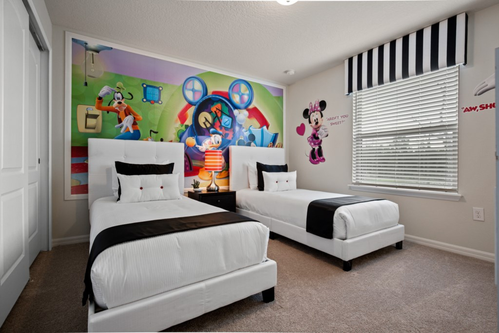 Mickey Mouse Clubhouse themed two twin beds and flat screen TV