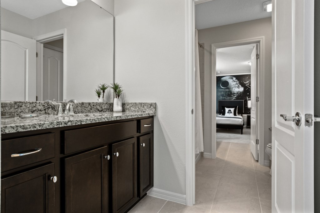 Jack & Jill Bathroom with shower, toilet, and vanity