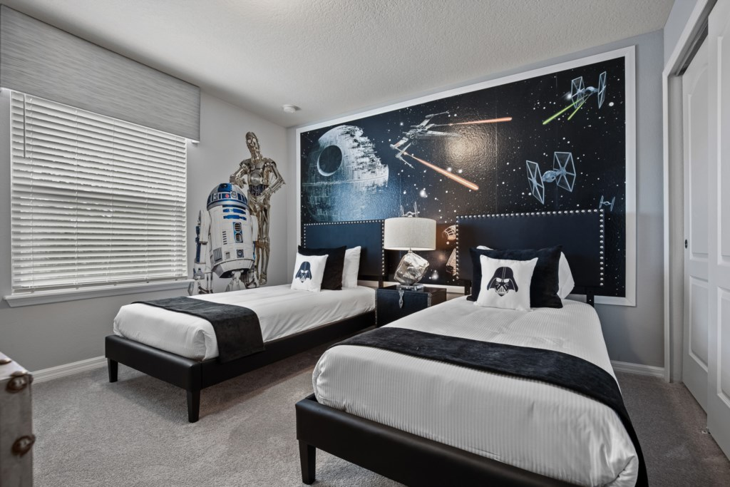 View 2 of Star Wars themed bedroom with two twin beds and flat screen TV