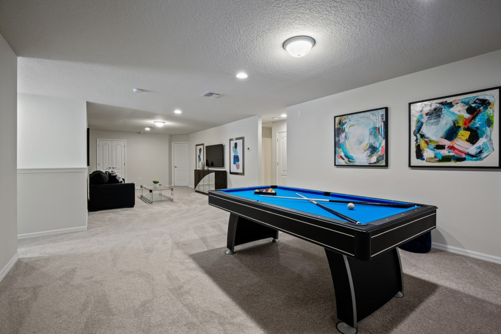 View 2 of amazing pool table with lounge area and flat screen TV