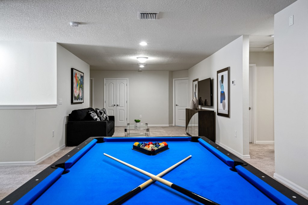 Amazing pool table with lounge area and flat screen TV
