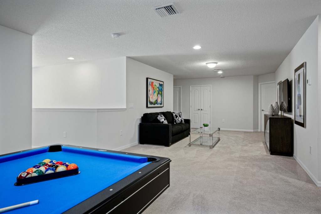 View 3 of amazing pool table with lounge area and flat screen TV