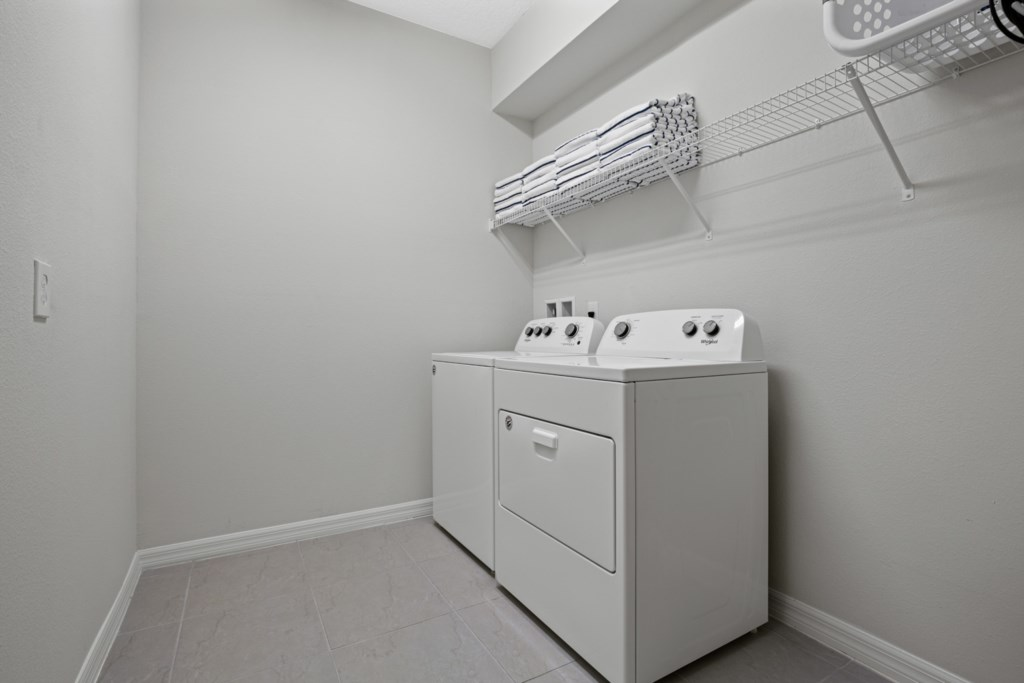 View 2 of convenient laundry room with full size washer and dryer