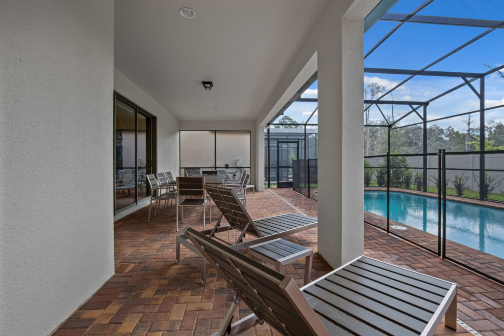 View 5 of luxurious pool and spa with loungers