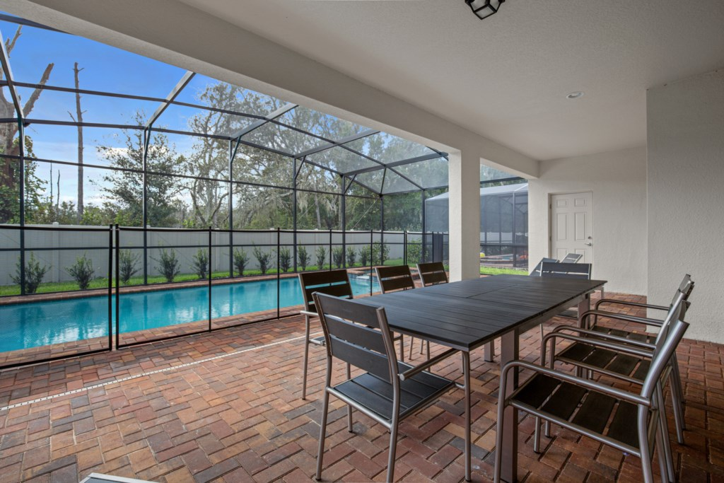 View 4 of luxurious pool and spa with patio furniture
