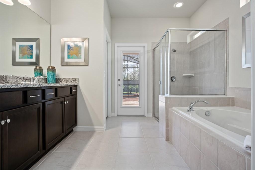 Stunning bathroom including tub, shower, and vanity sink