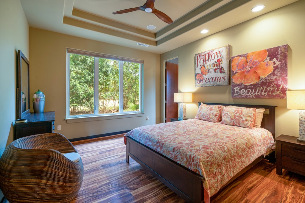 Cozy bedroom with Hawaiian flare for you rcomfort - with ceiling fan
