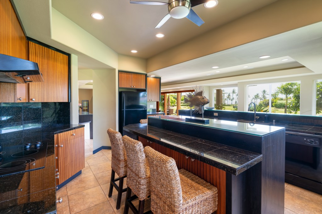 Spacious open fllor kitchen with island bar seating for 3