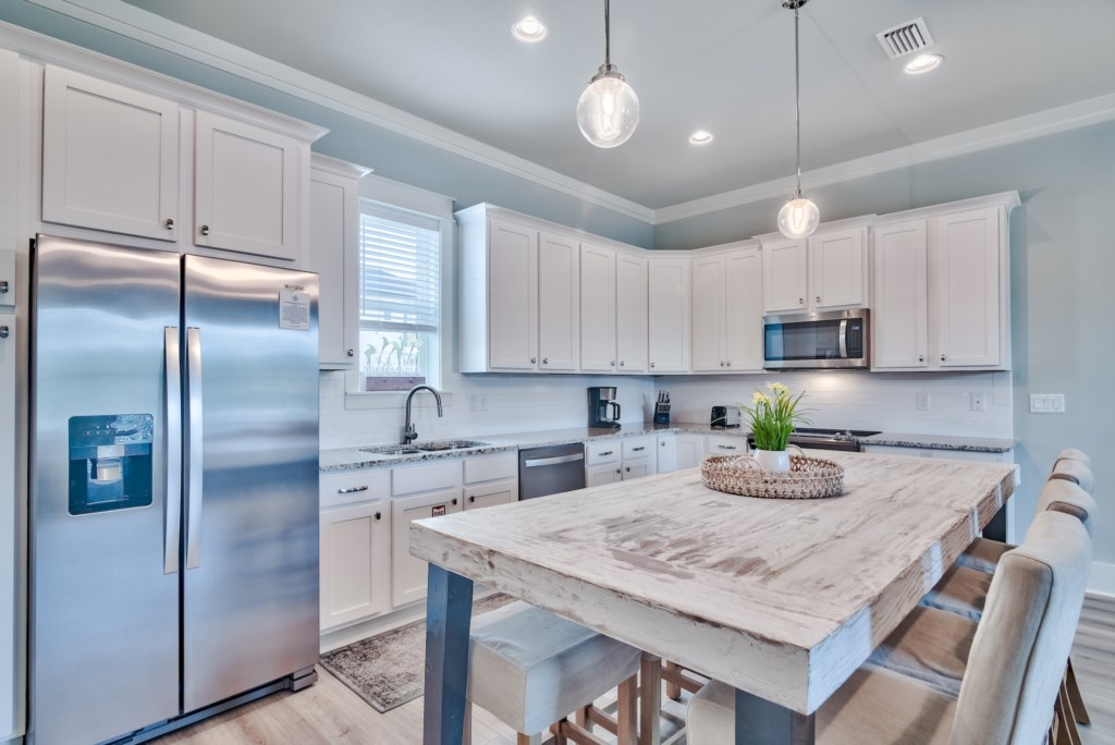 Beautiful Custom Cabinets and finishes in the open Kitchen/Dining area