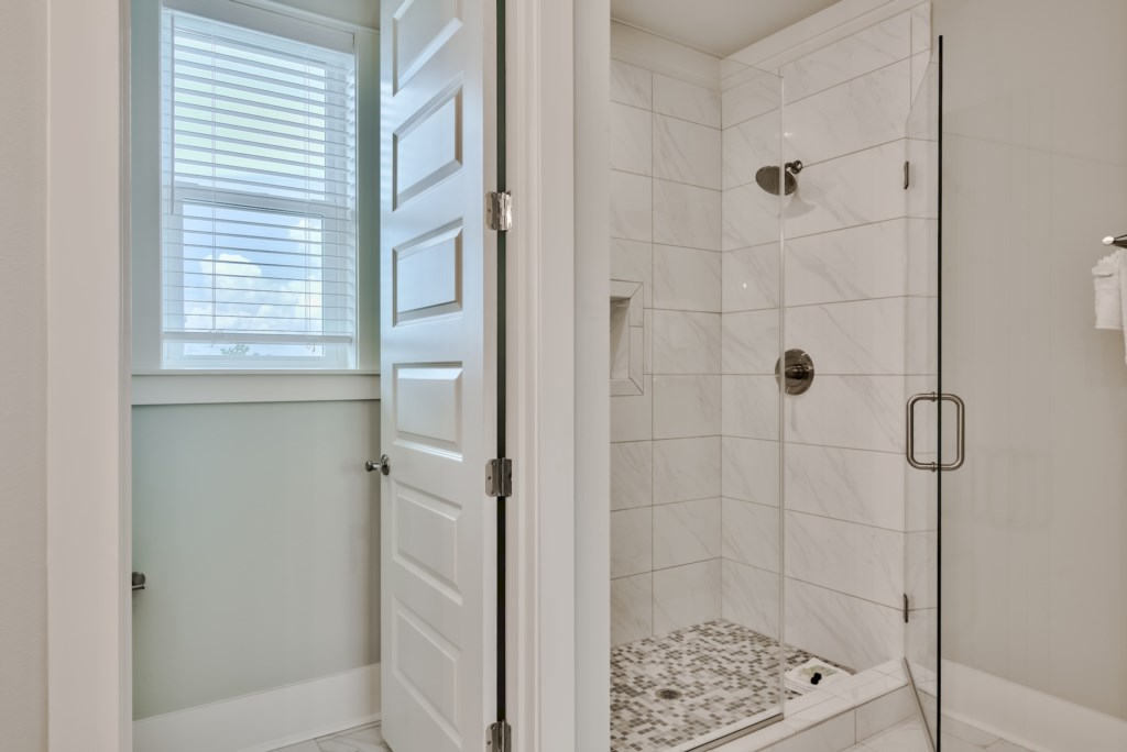 Walk-in Shower with tiled walls