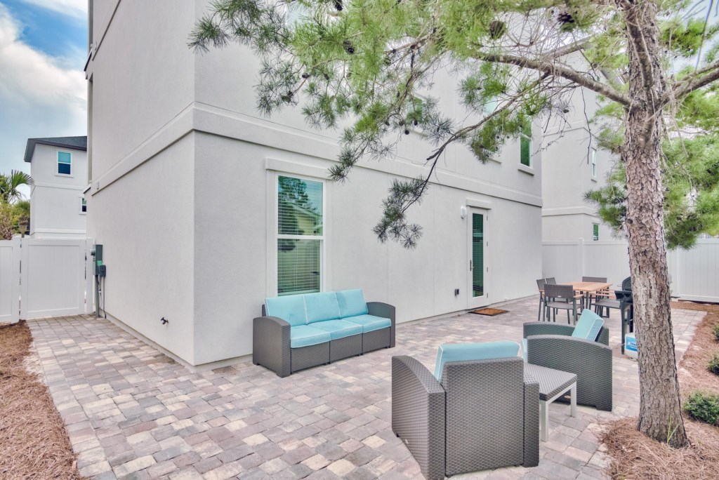 Relax on your private  patio area with comfortable seating