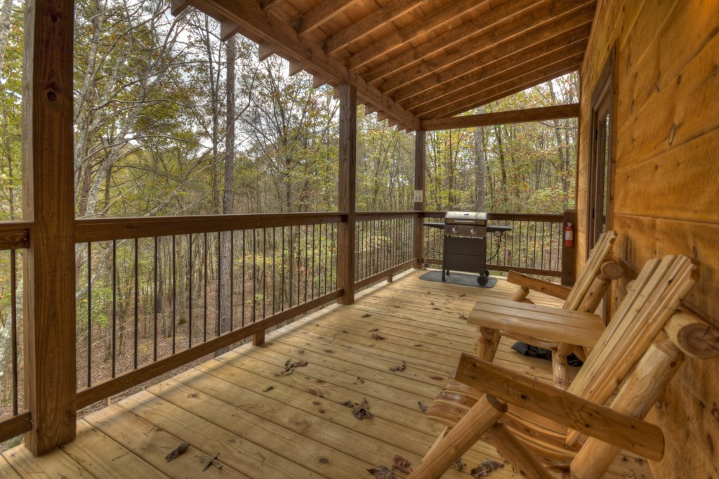 The porch has a grill and plenty of seating for outdoor entertaining or sipping your morning coffee