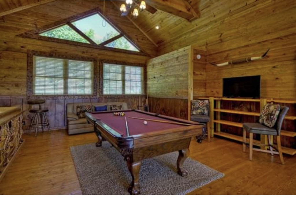 Bring out your competitive side in this Large Games Room