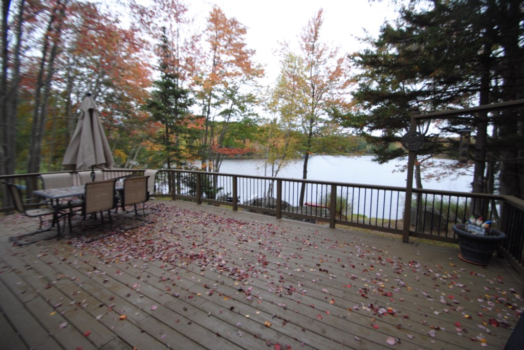 Walk out of the great room slider onto the large deck! Beautiful views of the lake, fishing dock and fire pit area!