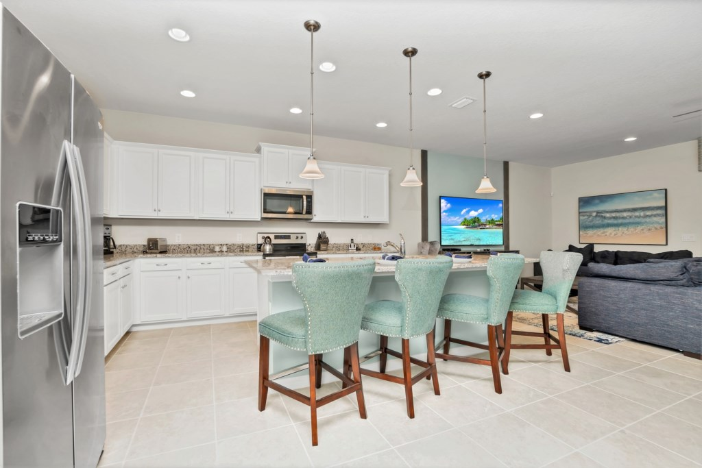 View 2 of gorgeous kitchen with barstool seating