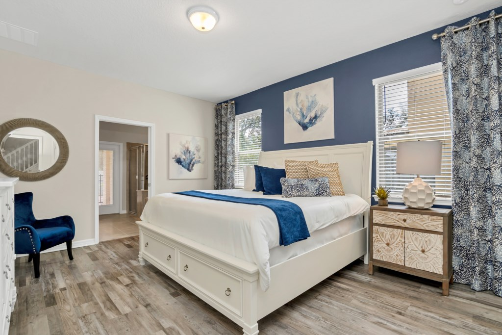 Stunning king bed with flat screen TV and access to patio