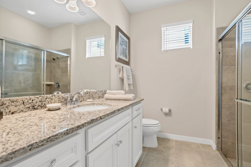 Beautiful single sink vanity with sliding glass shower