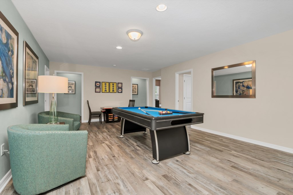 View 2 of game room pool table and board games