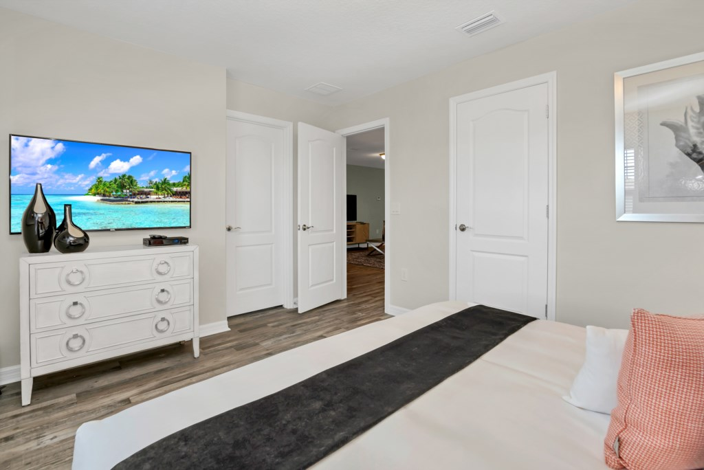 View 2 of luxurious king bed with flat screen TV