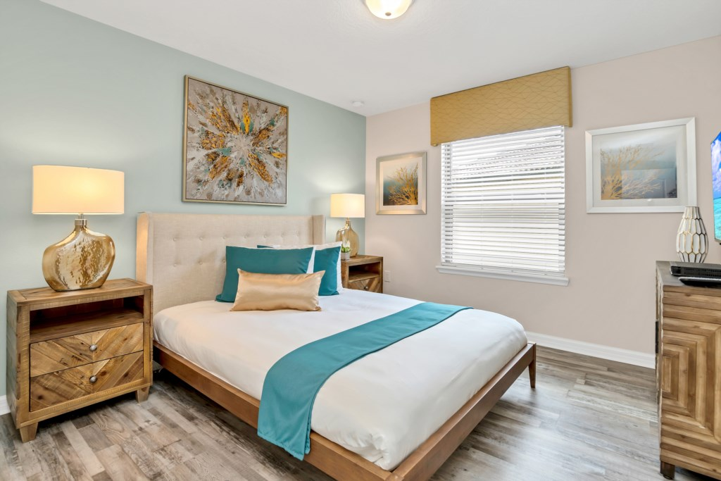 Lovely queen bed with flat screen TV