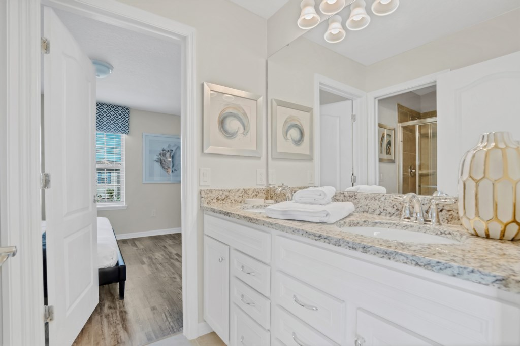 Jack & Jill bathroom with double sink vanity and shower