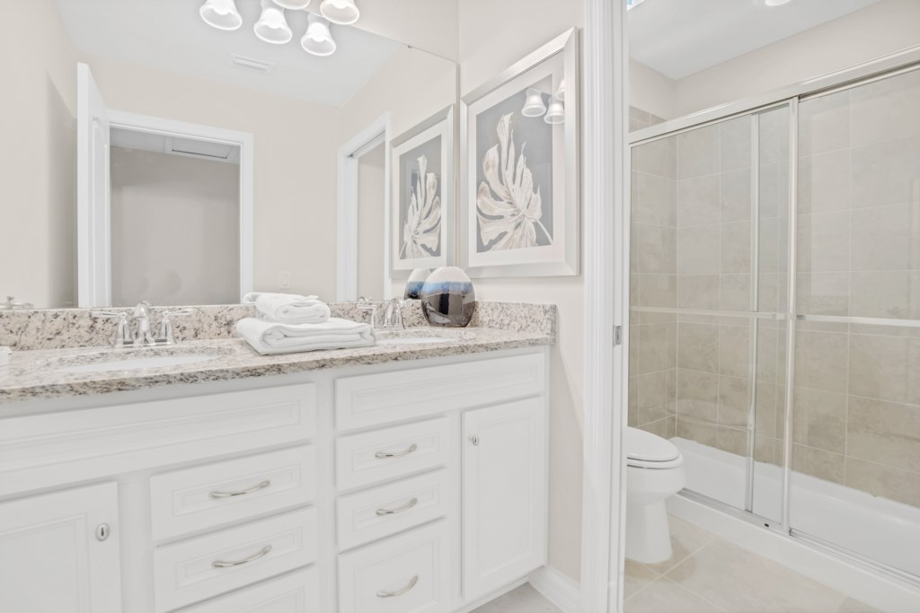 Classic double sink vanity wiith sliding glass shower