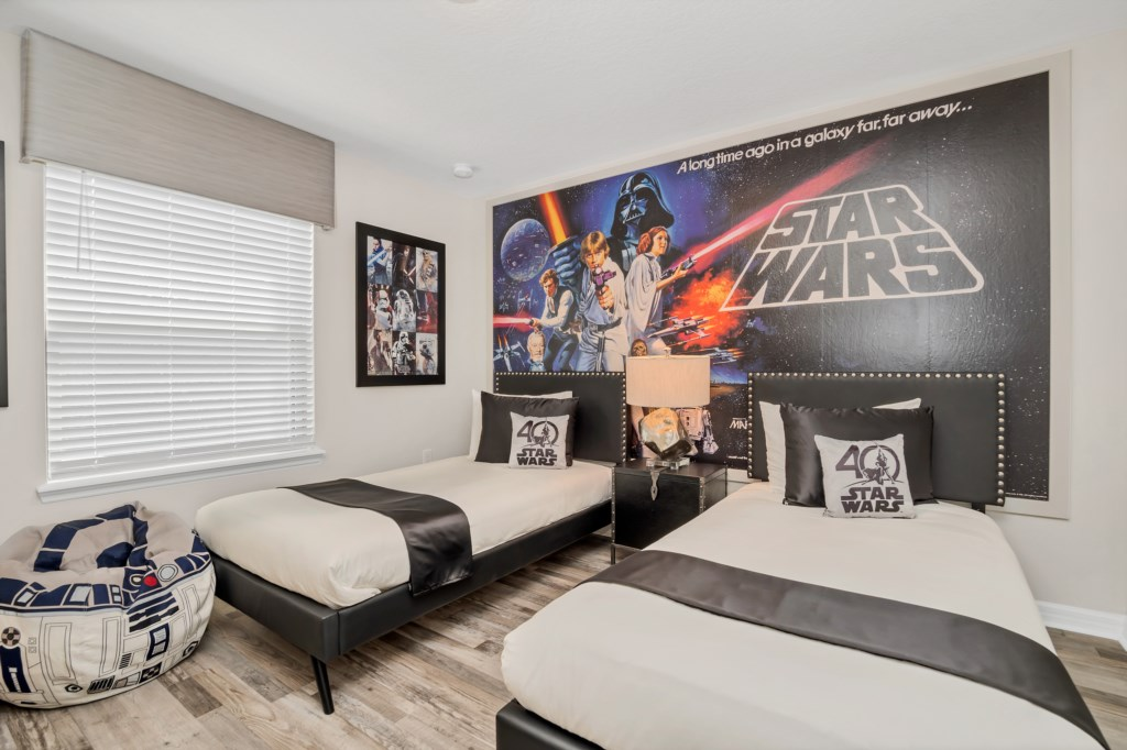 Amazing Star Wars themed twin bedroom with flat screen TV