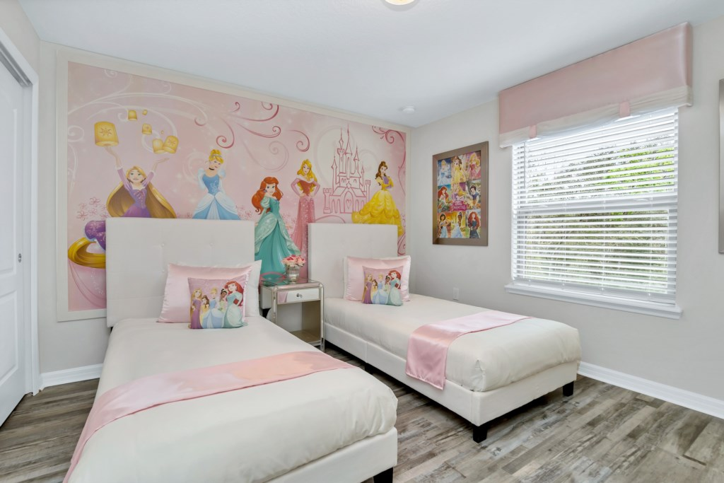 Adorable Princess themed twin bedroom with flat screen TV