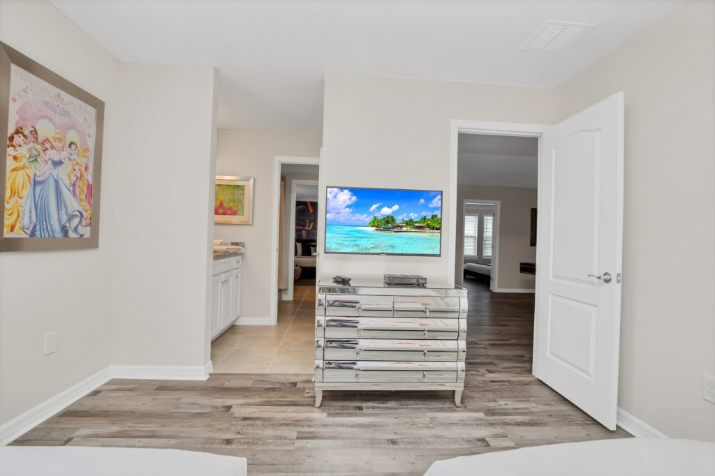 View 2 of adorable Princess themed twin bedroom with flat screen TV