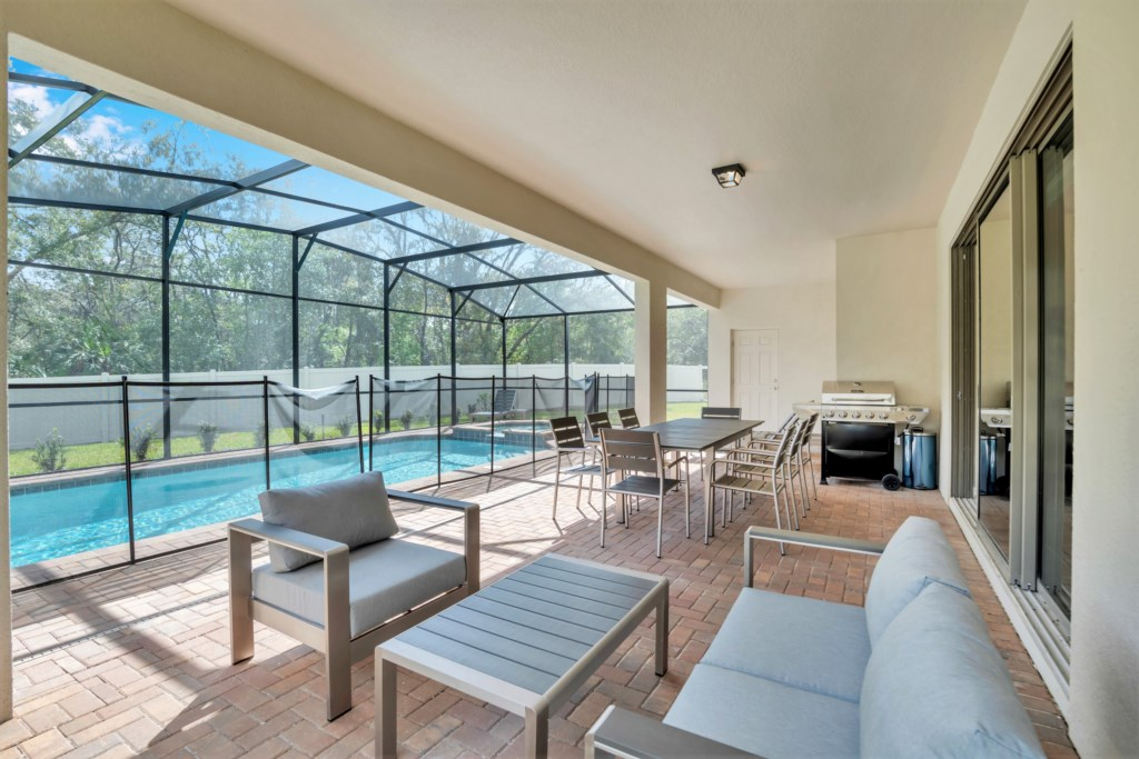 Outdoor patio area with seating and pool view
