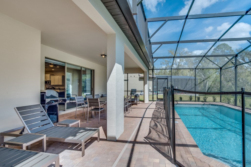 View 6 of luxurious pool and spa with safety fence