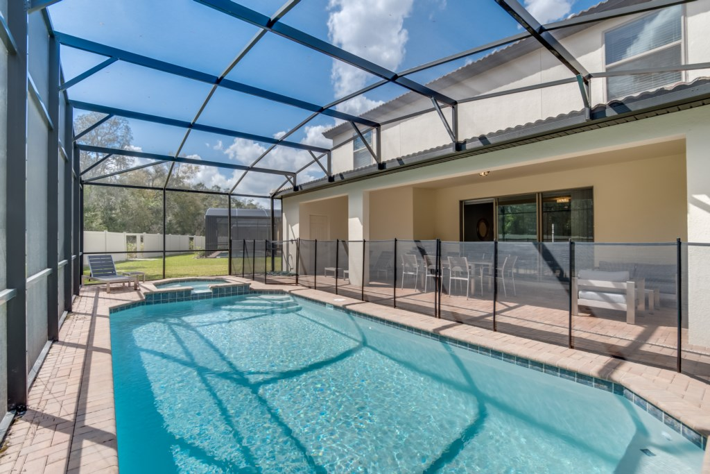 View 4 of luxurious pool and spa with pool screen