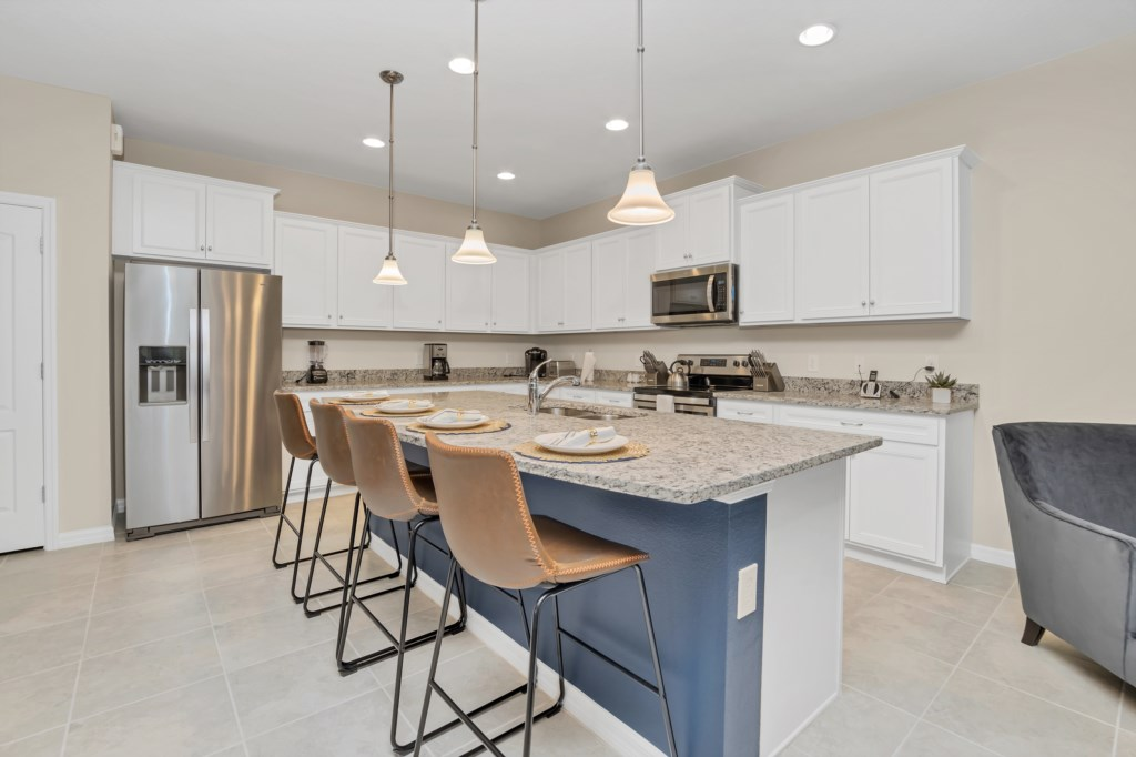 View 3 of gorgeous kitchen with barstool seating