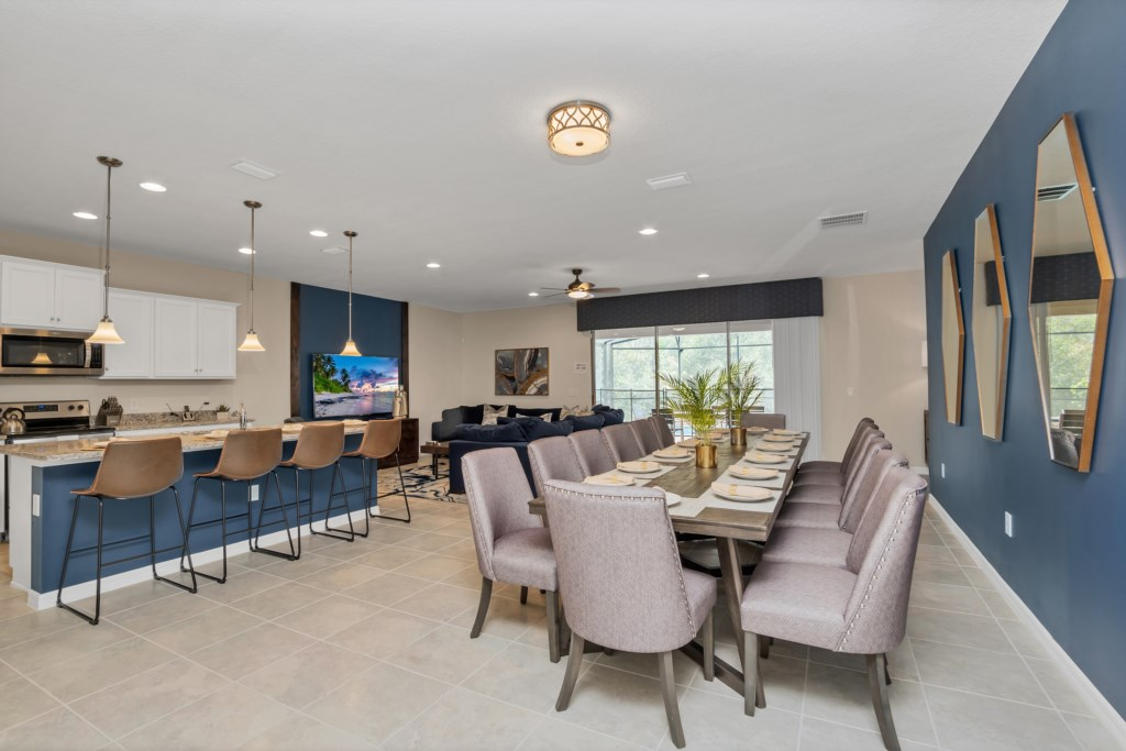 Spacious downstairs area with dining table and barstool seating