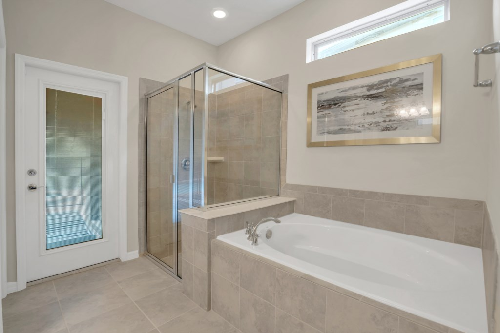 View 2 of stunning bathroom with tub, glass shower and access to patio