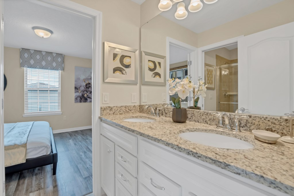 Grand double sink vanity bathroom with sliding glass shower