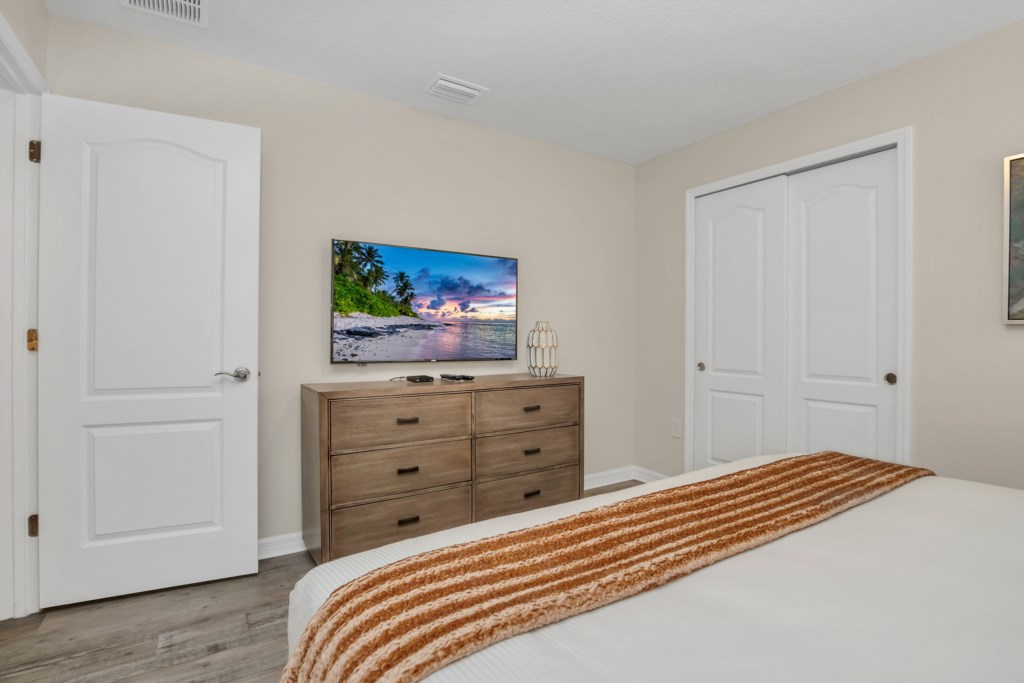 View 2 of beautiful king bed with flat screen TV