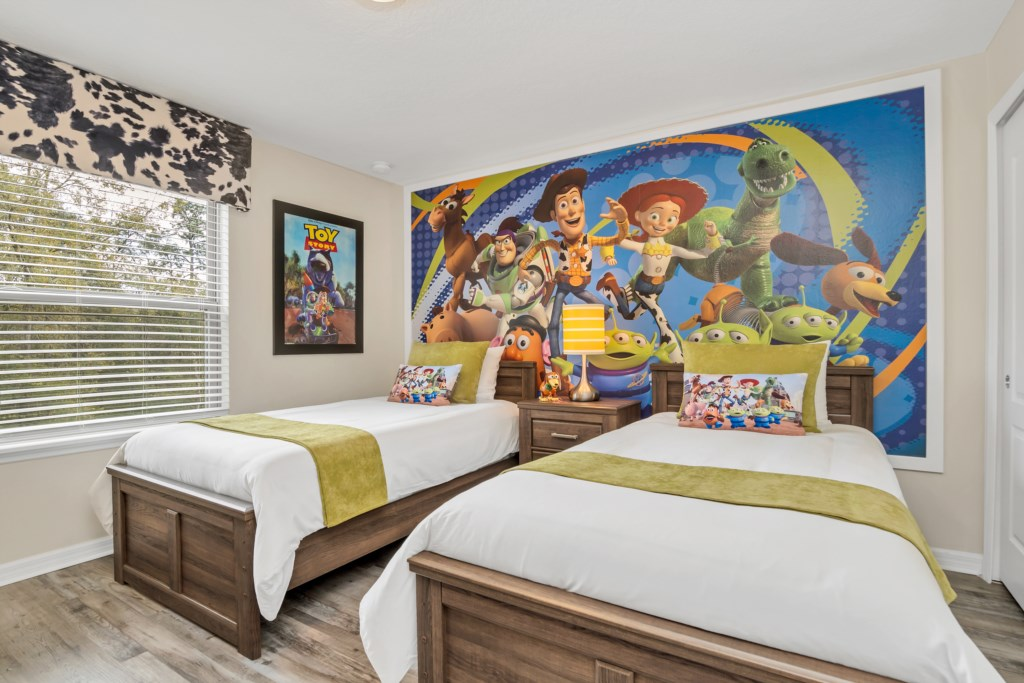 Adorable Toy Story themed twin bedroom with flat screen TV