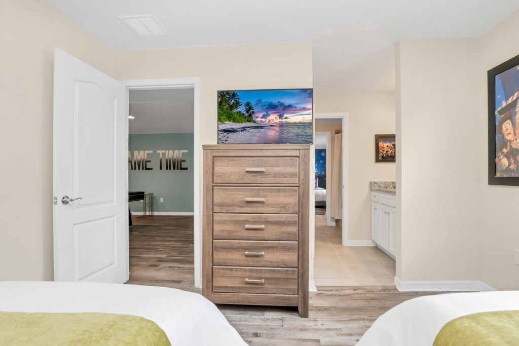 View 2 of adorable Toy Story themed twin bedroom with flat screen TV