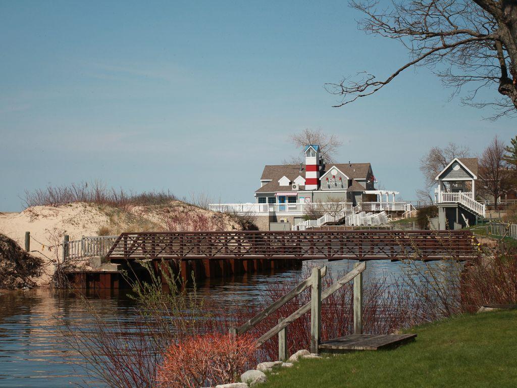 Bridge over Crystal River, leading to Lake Michigan