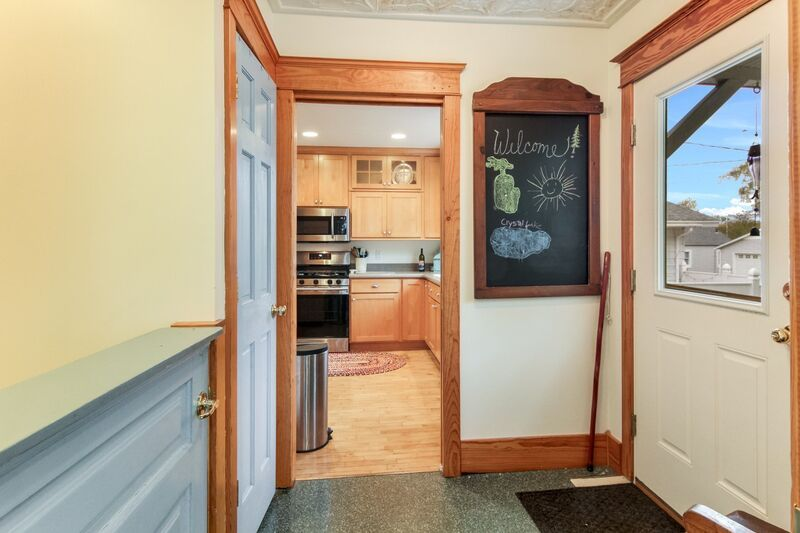 Entryway, leading into the kitchen